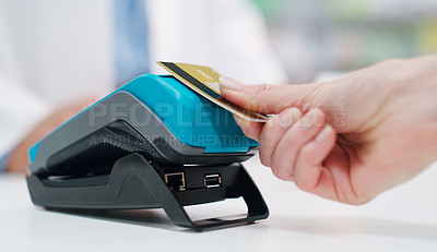 Buy stock photo Closeup shot of a customer making a credit card payment in a pharmacy