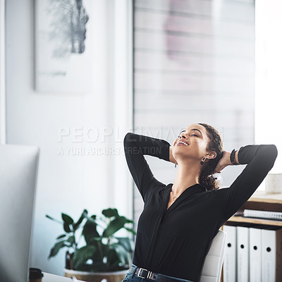 Buy stock photo Shot of a young businesswoman taking a break while working in an office