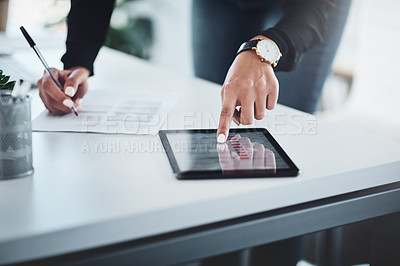 Buy stock photo Closeup shot of an unrecognisable businesswoman writing notes while using a digital tablet in an office