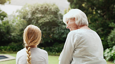 Buy stock photo Rearview shot of a grandmother and granddaughter bonding and spending time together outdoors