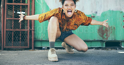 Buy stock photo Shot of an attractive young woman having fun on the sidewalk in an urban town