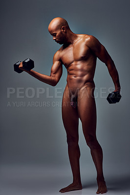 Buy stock photo Studio shot of a muscular young man working out with dumbbells naked against a grey background