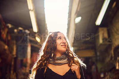 Buy stock photo Shot of a young woman exploring a marketplace in Israel