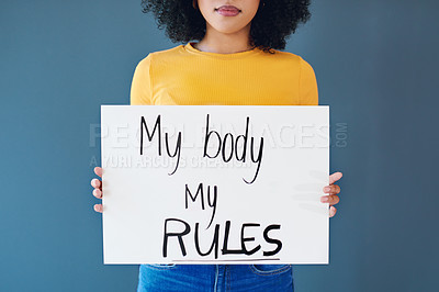 Buy stock photo Studio shot of an unrecognizable young woman holding a placard with the words