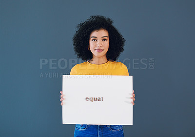 Buy stock photo Studio portrait of an attractive young woman holding a placard with the words