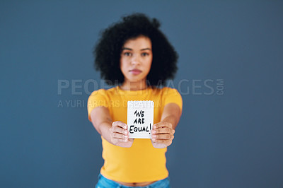 Buy stock photo Studio portrait of an attractive young woman holding up a placard with gender symbols on it against a grey background