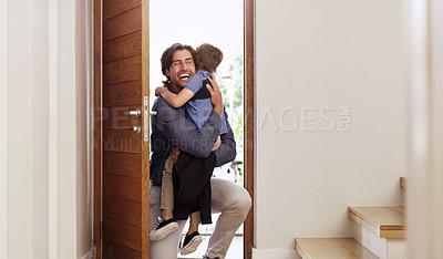 Buy stock photo Shot of a happy father hugging his young son after coming home from work