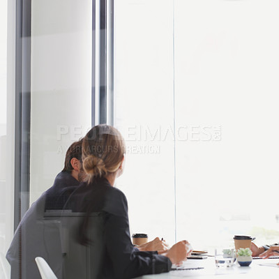 Buy stock photo Shot of two businesspeople having a meeting in a boardroom