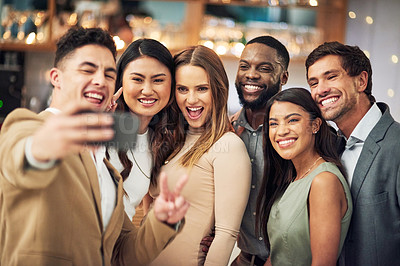 Buy stock photo Cropped shot of a group of young friends posing for a selfie together in a bar