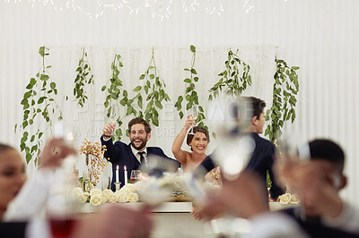 Buy stock photo Shot of a happy middle aged couple sitting together at their wedding reception