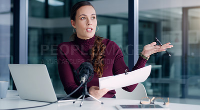 Buy stock photo Cropped shot of an attractive young businesswoman sitting alone in her office and speaking through a microphone during an interview