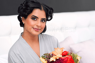 Buy stock photo Shot of a beautiful young woman holding a bunch of flowers before her wedding