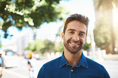 Buy stock photo Closeup shot of a handsome middle-aged man spending the day out in the city
