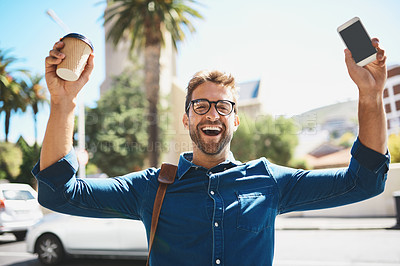 Buy stock photo Shot of a man looking cheerful while holding a coffee and his cellphone
