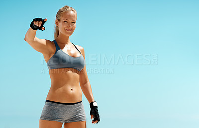 Buy stock photo Cropped portrait of a beautiful young woman pointing at you while exercising outdoors