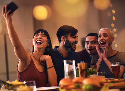 Buy stock photo Cropped shot of friends enjoying a meal together at a restaurant