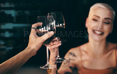 Buy stock photo Cropped shot of a beautiful young woman sharing a toast with her date
