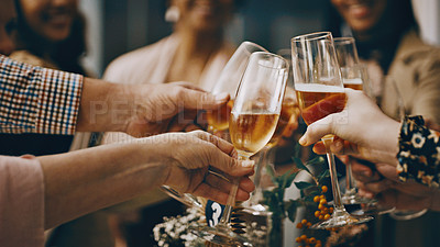 Buy stock photo Cropped shot of a group of unrecognizable people toasting their drinking glasses at a wedding