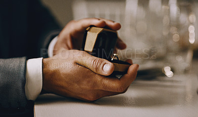 Buy stock photo Cropped shot of an unrecognizable man's hands holding a box with a wedding ring inside