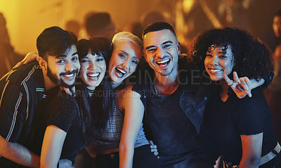Buy stock photo Cropped portrait of a diverse group of young friends having fun at a party in a nightclub