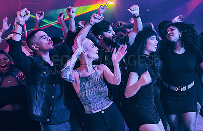 Buy stock photo Cropped shot of a group of energetic young people dancing at a party in a nightclub