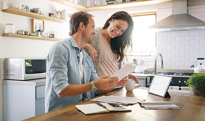 Buy stock photo Cropped shot of an affectionate young couple looking cheerful while going through their budget at home