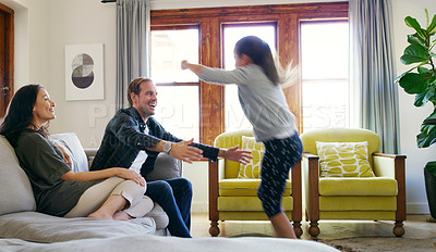 Buy stock photo Cropped shot of an affectionate young girl running to hug her father in their living room at home