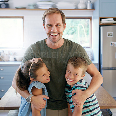 Buy stock photo Cropped shot of an affectionate young father embracing his two kids in their kitchen at home