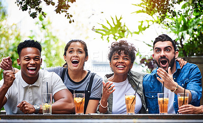Buy stock photo Shot of a group of young friends having drinks and enjoying themselves at an outdoor cafe
