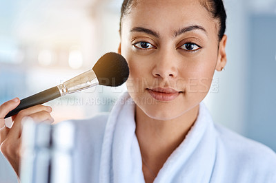 Buy stock photo Cropped shot of a young woman getting ready in the bathroom at home