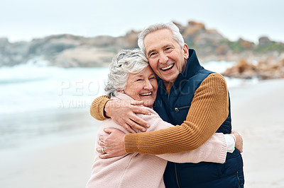 Buy stock photo Shot of a senior couple enjoying some quality time together at the beach