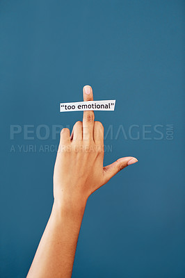 Buy stock photo Studio shot of an unrecognizable woman's hand showing the middle finger while a note that has the words