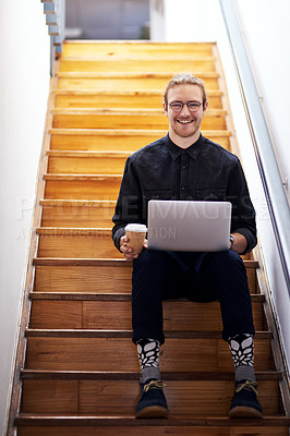 Buy stock photo Full length portrait of a handsome young businessman sitting alone on the staircase alone and using his laptop