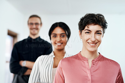Buy stock photo Cropped portrait of a diverse group of businesspeople smiling and standing in a line in the office