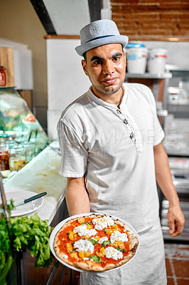 Buy stock photo Cropped shot of a worker holding a plate of food in a restaurant
