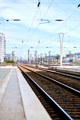Buy stock photo Cropped shot of the cityscape overlooking a railway line in an empty train station in Portugal