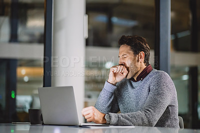 Buy stock photo Cropped shot of a handsome mature businessman feeling tired and yawning while sitting alone in his office late at night
