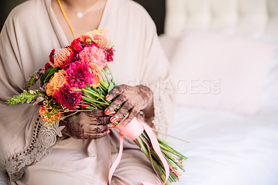 Buy stock photo Cropped shot of an unrecognizable woman holding a bunch of flowers before her wedding