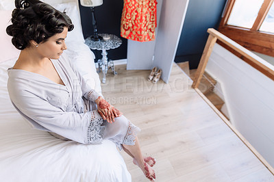 Buy stock photo Shot of a beautiful young woman looking sad while getting ready for her wedding