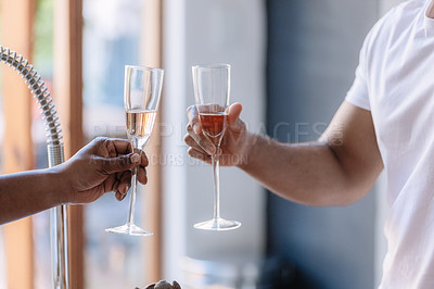 Buy stock photo Cropped shot of two men toasting with wine at home