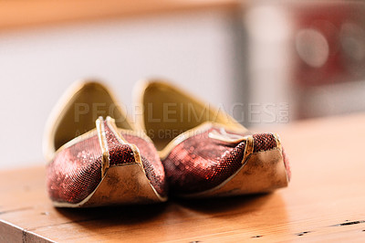 Buy stock photo Shot of men's shoes on a table before a wedding ceremony