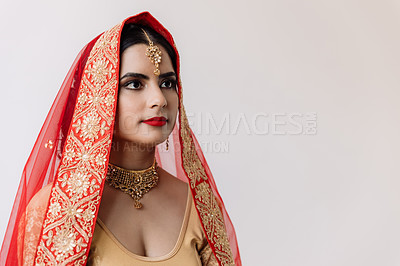 Buy stock photo Shot of a beautiful young young woman looking thoughtful on her wedding day