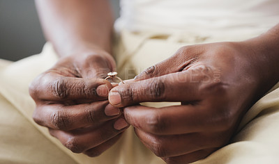 Buy stock photo Cropped shot of an unrecognizable man holding a ring in preparation for his wedding