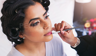 Buy stock photo Shot of a beautiful young woman getting her makeup done on her wedding day