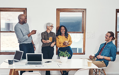 Buy stock photo Shot of a cheerful mature businesswoman holding up her cellphone for her work colleagues to look on the screen inside of the office