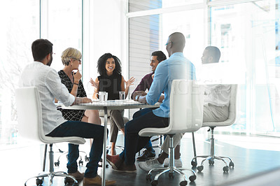 Buy stock photo Full length shot of an attractive young businesswoman brainstorming with her colleagues during a meeting in the boardroom