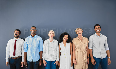 Buy stock photo Studio portrait of a diverse group of businesspeople smiling while standing against a grey background