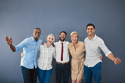 Buy stock photo Studio portrait of a diverse group of businesspeople cheering while standing against a grey background