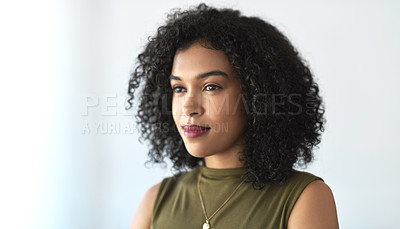 Buy stock photo Cropped shot of an attractive young businesswoman standing in a modern office