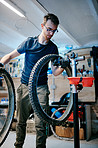 He builds bicycles to custom specifications